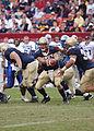 US Navy 031004-N-5596B-002 Navy quarterback Craig Candeto hands off to fullback Kyle Eckel.jpg
