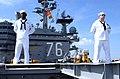 US Navy 040527-N-9319H-022 Sailors aboard USS Ronald Reagan man the rails while preparing to get underway.jpg
