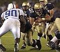 US Navy 040904-N-9693M-009 U.S. Naval Academy Midshipman 1st Class Kyle Eckel runs for a touchdown against the Duke Blue Devils.jpg