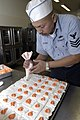 US Navy 050215-N-2636M-015 Petty Officer in Charge, Naval Air Station North Island Bakery, Culinary Specialist 1st Class Nick Leones, decorates the desserts that will be served to the 1600 Sailor's that come to dine at th.jpg