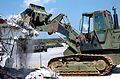 US Navy 050309-N-9712C-001 A track loader operated by Equipment Operator 1st Class John Romero, tears down the vehicle dispatch office building on Camp Shields, Okinawa.jpg
