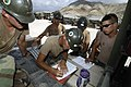 US Navy 050507-N-3642E-002 Equipment Operator 1st Class Petty Officer Christopher Bowhuis, finalizes the plan to stage equipment to be moved from Camp Unity, Haiti, to a local port.jpg
