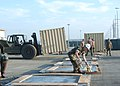 US Navy 060831-N-3560G-035 Members of Naval Mobile Construction Battalion Four (NMCB-4) prepare shipping pallets for Tricon containers.jpg