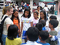 US Navy 061102-N-0913B-061 Operations Specialist Seaman Stacie A. Hutchinson spends time with students from the San Felipe Elementary School East in the city of Zambales.jpg
