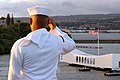 US Navy 070409-N-1635S-002 A Sailor salutes the USS Arizona Memorial from the flight deck of USS Ronald Reagan (CVN 76) as they pull into Pearl Harbor, Hawaii.jpg