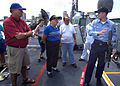 US Navy 070427-N-0857S-006 Fire Controlman 2nd Class Travis Rice explains the operation of the M-240 machine gun to members of the public.jpg