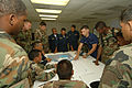 US Navy 070507-N-0989H-050 Boatswain's Mate 2nd Class Juan Rodriguez, Expeditionary Training Command, assists Panamanian National Maritime Service members with finding a point on a map given the latitude and longitude during tr.jpg