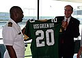 US Navy 070625-N-7163S-006 Prospective commanding officer of Precommssioning Unit (PCU) Green Bay (LPD 20) Cmdr. Cal Slocumb and Green Bay resident Rick Beverstein admire a jersey anticipating the commissioning of USS Green Bay.jpg