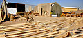 US Navy 080202-N-0553R-010 A Seabee assigned to Naval Mobile Construction Battalion (NMCB) 1 carries a prefabricated truss to be used in the construction of Southwest Asia Huts at Camp Ramadi, Iraq.jpg