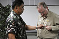 US Navy 080702-N-3659B-231 Armed Forces of the Philippines (AFP) Brig. Gen. Jorge V. Segovia presents Rear Adm. James P. Wisecup, commander of the Ronald Reagan Carrier Strike Group, with the AFP Disaster Response and Recovery.jpg