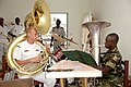 US Navy 080915-N-6544L-480 ousaphone player Musician 3rd Class Nick Schmit and Gabonese Army tuba player Sgt. Minko Gontran play together at the Prytanee School.jpg