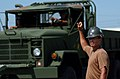 US Navy 080930-N-3674H-133 Builder 2nd Class Stephen Leguillow guides the driver of a medium tactical vehicle.jpg