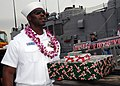 US Navy 081219-N-9758L-138 Information Systems Technician 2nd Class Ryan Jurode departs USS Reuben James (FFG 57) with Christmas presents during the ship's return to Naval Station Pearl Harbor.jpg