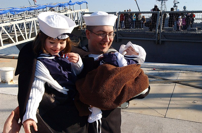 File:US Navy 090206-N-4049C-015 Gas Turbine System Technician (Electrical) 2nd Class Randy Jackson is welcomed home by his daughters after a six-month deployment aboard the guided-missile frigate USS Taylor (FFG 50).jpg