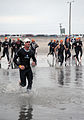 US Navy 090329-N-2959L-318 An individual competitor races through the surf ahead of relay competitors during the 31st annual SUPERFROG Triathlon at Silver Strand State Beach.jpg