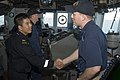 US Navy 090516-N-0743B-053 Capt. Chang Jun Tao, assigned to the Republic of Singapore Navy amphibious ship RSS Persistence (LPDM 209), meets Officer of the Deck Lt. j.g. Dennis Panos aboard the guided-missile cruiser USS Gettys.jpg