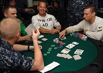 "Poker - A game of Texas hold 'em in progress. ""Hold 'em"" is a popular form of poker."