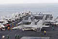 US Navy 090706-N-9132C-002 Hornets and Super Hornets are secured on the flight deck as they are repositioned in preparation to launch from the aircraft carrier USS Ronald Reagan (CVN 76).jpg