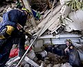 US Navy 100114-N-6266K-033 Members of Fairfax County Urban Search and Rescue conduct a rescue operation in a collapsed section of the Hotel Montana in Port-au-Prince, Haiti during a search for survivors of a 7.0 magnitude earth.jpg