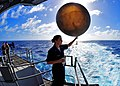 US Navy 100219-N-2953W-260 erographer's Mate 2nd Class Elizabeth Clements prepares to release a weather balloon from the fantail of USS Carl Vinson (CVN 70).jpg
