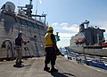 US Navy 100220-N-7058E-381 Chief Logistics Specialist Keith Wilkerson, assigned to the littoral combat ship USS Freedom (LCS 1) signals the Military Sealift Command fleet replenishment oiler USNS Leroy Grumman.jpg