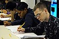 US Navy 100304-N-6307R-052 Sailors aboard the aircraft carrier USS Carl Vinson (CVN 70) take the E-6 advancement exam on the aft mess decks. Carl Vinson is underway supporting Southern Seas 2010. (.jpg