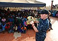 US Navy 100408-N-6138K-138 Musician 2nd Class Allison Baine performs for more than 300 children at the Colin Powell Cultural Center.jpg