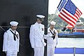 US Navy 100731-N-8467N-008 Sailors aboard the Virginia-class attack submarine USS Missouri (SSN 780) bow their heads during the boat's commissioning ceremony.jpg