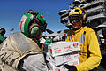 US Navy 101109-N-9132C-071 Sailors aboard the aircraft carrier USS Ronald Reagan (CVN 76) take boxes of food supplies off a C-2A Greyhound logistic.jpg