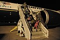 US Navy 110322-N-VA590-174 Family members of U.S. military personnel board a flight to the continental United States during an authorized voluntary.jpg