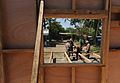 US Navy 110323-N-WX845-129 Sailors assigned to Naval Mobile Construction Battalion (NMCB) 28 construct the foundation for a Southeast Asia hut at I.jpg