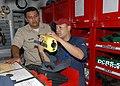US Navy 110419-N-ZI300-116 Hull Technician Fireman Edward Lopez explains firefighting equipment and techniques to Mexican navy Lt. Roman Alfonso Sa.jpg