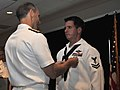 US Navy 110714-N-ZZ999-004 Hospital Corpsman 2nd Class Jacob Emmott is awarded the Silver Star medal by Vice Chief of Naval Operations Adm. Jonatha.jpg
