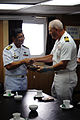 US Navy 110727-N-XD424-114 Capt. William Johnson, right, gives Capt. Alberto A. Cruise a plaque.jpg