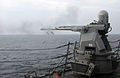 US Navy 111101-N-XQ375-396 A MK-38 25mm machine gun fires during a weapons exercise aboard the guided-missile destroyer USS Mitscher (DDG 57).jpg
