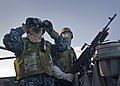US Navy 111114-N-RI884-017 Members of port bridge wing SCAT team stand watch aboard the guided-missile destroyer USS O'Kane.jpg