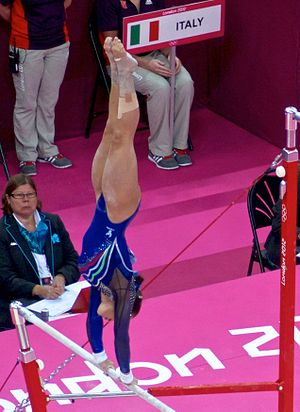 Erika Fasana - Fasana competing on the uneven bars during qualification at the 2012 Summer Olympics on 29 July 2012