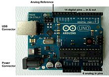 An official Arduino Uno with descriptions of the I/O locations