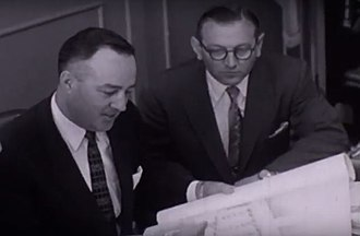 Utica Mayor John T. McKennan (left) and Structural Engineer Lev Zetlin (right) signing documents for construction of the Utica Memorial Auditorium in the 1950s. Utica Mayor John T. McKennan.jpg