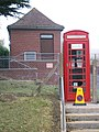 Vandalised Telephone Kiosk by Telephone exchange - geograph.org.uk - 1574197.jpg