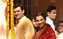 Vidya Balan and Siddharth Roy Kapur are smiling at the camera.