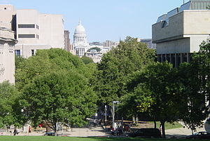 A view of the Wisconsin State Capitol from atop Bascom Hill. Mosse Humanities building is on the right while the Wisconsin Historical Society (fore) and Memorial Library (rear) on the left.