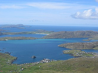 Outer Hebrides - View of the Barra Isles from Heaval. The village of Castlebay is in the foreground, with Vatersay, and the uninhabited islands of Sandray, Pabbay, Mingulay and Berneray beyond.
