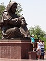 Visitors at Statue of Mourning Mother - Samani Park - Bukhara - Uzbekistan (7519964400).jpg