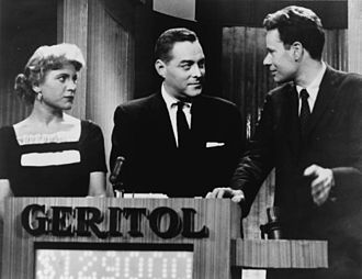 Twenty One (game show) - Twenty One host Jack Barry (center), with contestants Vivienne Nearing and Charles Van Doren.