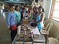 Volunteers selling books in Goa, India.jpg