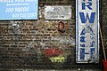 Wall with Lock, Signs and Paint - geograph.org.uk - 788408.jpg