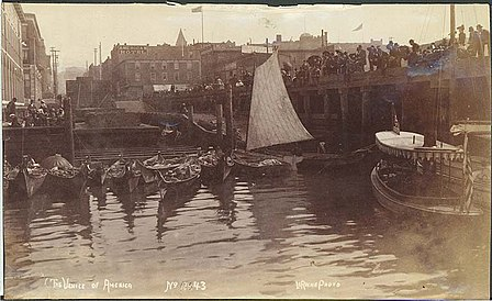Seattle waterfront with moored Indian canoes, Seattle, c. 1892