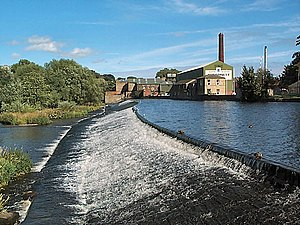 Otley - Weir on the River Wharfe at Otley with Garnett's paper mill behind