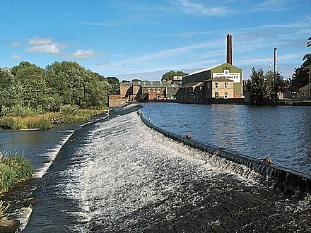 Weir on the River Wharfe at Otley with Garnett's paper mill behind Weir on the River Wharfe at Otley - geograph.org.uk - 45975.jpg